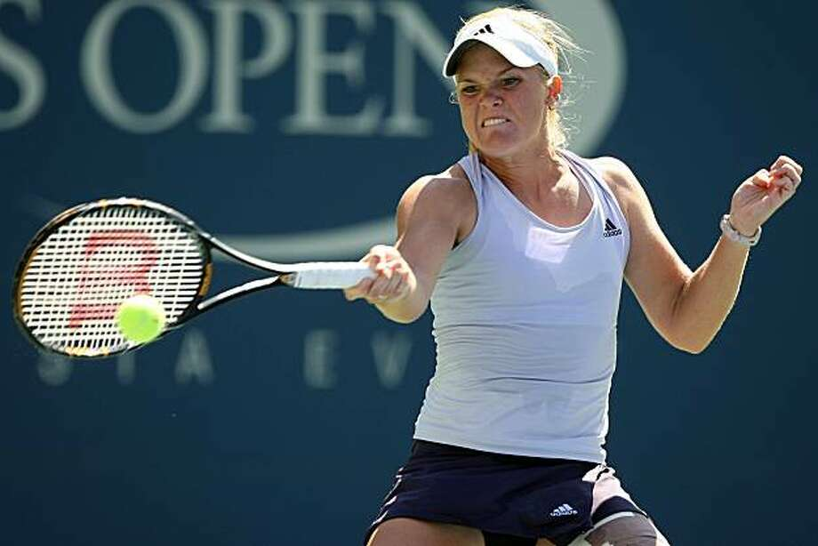 NEW YORK - SEPTEMBER 03:  Melanie Oudin returns a shot against Elena Dementieva of Russia during day four of the 2009 U.S. Open at the USTA Billie Jean King National Tennis Center on September 3, 2009 in Flushing neighborhood of the Queens borough of New York City.  (Photo by Al Bello/Getty Images) Photo: Al Bello, Getty Images