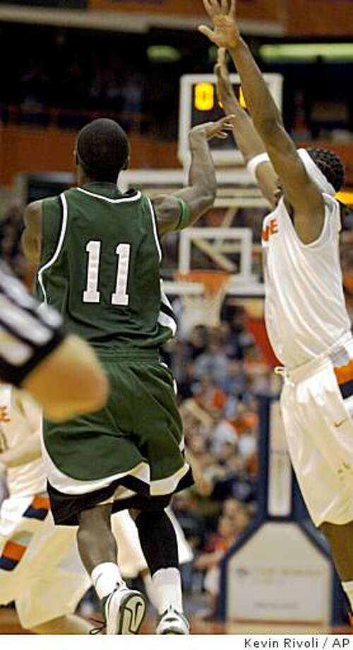 Cleveland State's Cedric Jackson (11) shoots the game-winning shot at the buzzer to defeat Syracuse 72-69 in NCAA college basketball in Syracuse, N.Y., Monday, Dec. 15, 2008. (AP Photo/Kevin Rivoli) Photo: Kevin Rivoli, AP