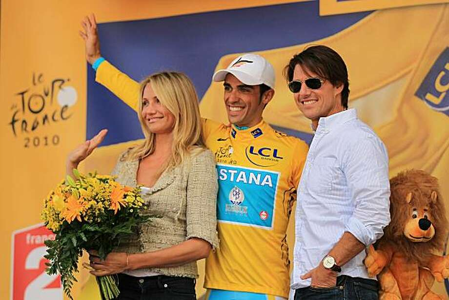 BORDEAUX, FRANCE - JULY 23: Actor Tom Cruise and actress Cameron Diaz stand on the podium with cyclist Alberto Contador after he was presented the yellow jersey at the conclusion of stage 18 of the Tour de France on July 23, 2010 in Bordeaux, France. England's Mark Cavendish won the stage while Spaniard Contador kept the race leaders yellow jersey. The iconic bicycle race will include a total of 20 stages and will cover 3,642km before concluding in Paris on July 25. Photo: Spencer Platt, Getty Images