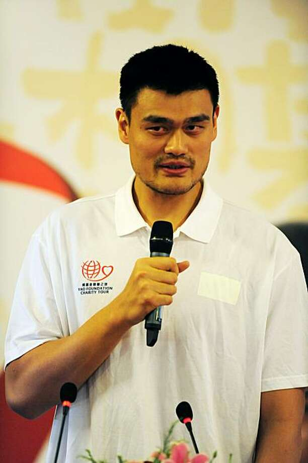Houston Rockets center Yao Ming takes part in a press conference for Yao Foundation Charity Tour, in Beijing on July 22, 2010. Yao thinks it will take at least one injury-free NBA season before he can even start thinking about regaining his best form forthe Houston Rockets. Photo: Franko Lee, AFP/Getty Images