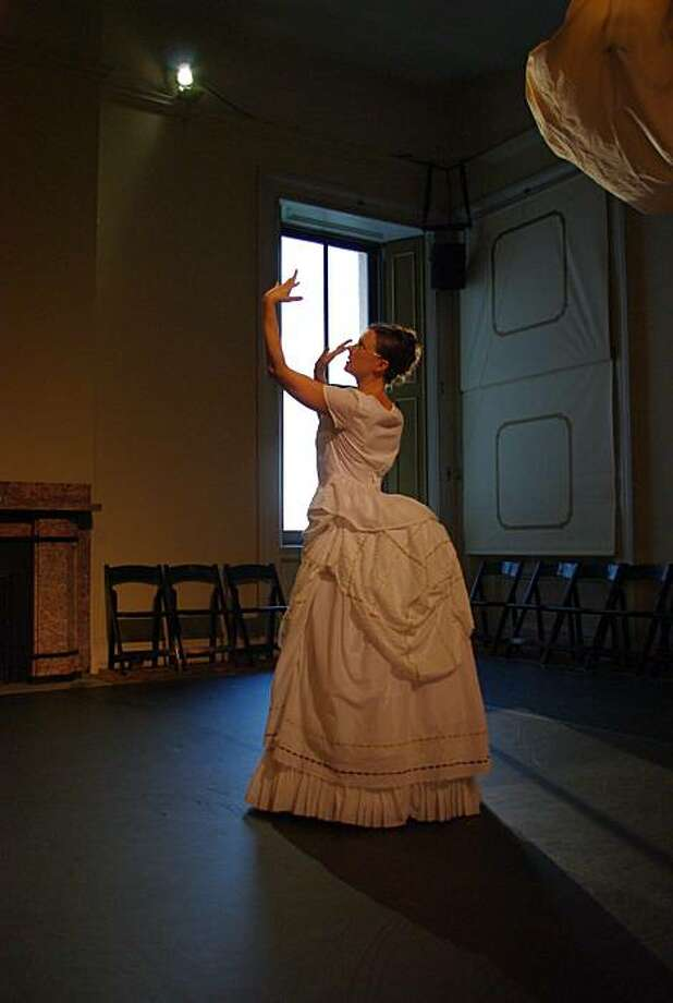 "Jessica Swanson in the floating bustle dress Joe Goode's ""Traveling Light, "" at the Old Mint Photo: Chida Chaemchaeng, Joe Goode Performance Group"