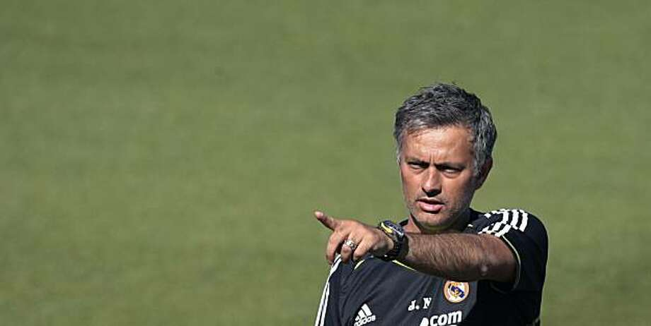 Real Madrid's coach Jose Mourinho gestures during his first training session with the team at the Valdebebas training center in Madrid, Friday, July 16, 2010. (AP Photo/Arturo Rodriguez). Photo: Arturo Rodriguez, AP
