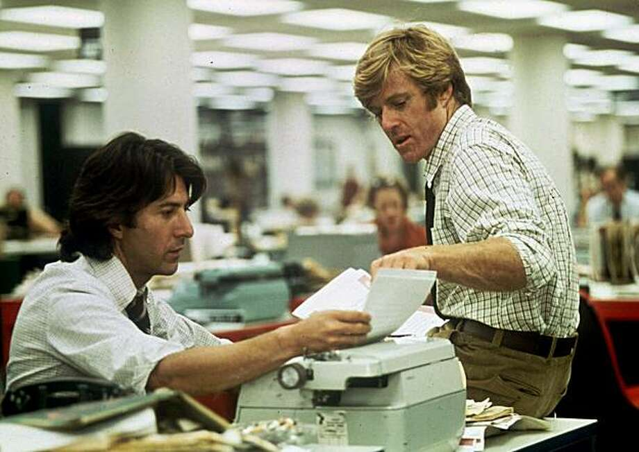 "FILE--Robert Redford, right, and Dustin Hoffman portray Washington Post reporters Bob Woodward and Carl Bernstein in the movie, ""All the President's Men."" Alan Pakula, who directed the films ``Klute'' and ``All The President's Men,'' died Thursday Nov. 19, 1998 in a car accident at the age of 70. Pakula was driving on the Long Island Expressway when a metal pipe crashed through the windshield, striking him in the head, said Suffolk County Police spokesman Officer Santo DiStefano. (AP Photo/file) Photo: AP File"