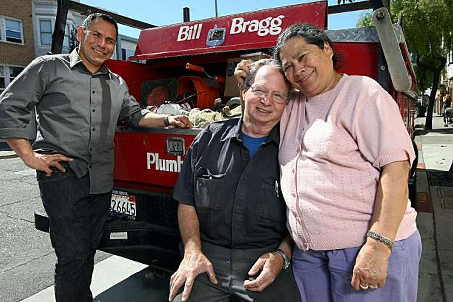 Edwin Floresreyes, left, Bill Bragg, middle, and Elsa Bragg, right, stand in front of a Bill Bragg Plumbing truck on Guerrero Street in San Francisco Thursday, July 15, 2010. Floresreyes who has worked as the office manager at Bill Bragg Plumbing for seven years, is a naval reservist and recently nominated Bragg for a rare DOD award that goes to businesses who help reservists balance military and civilian careers. Photo: Erin Lubin, Special To The Chronicle