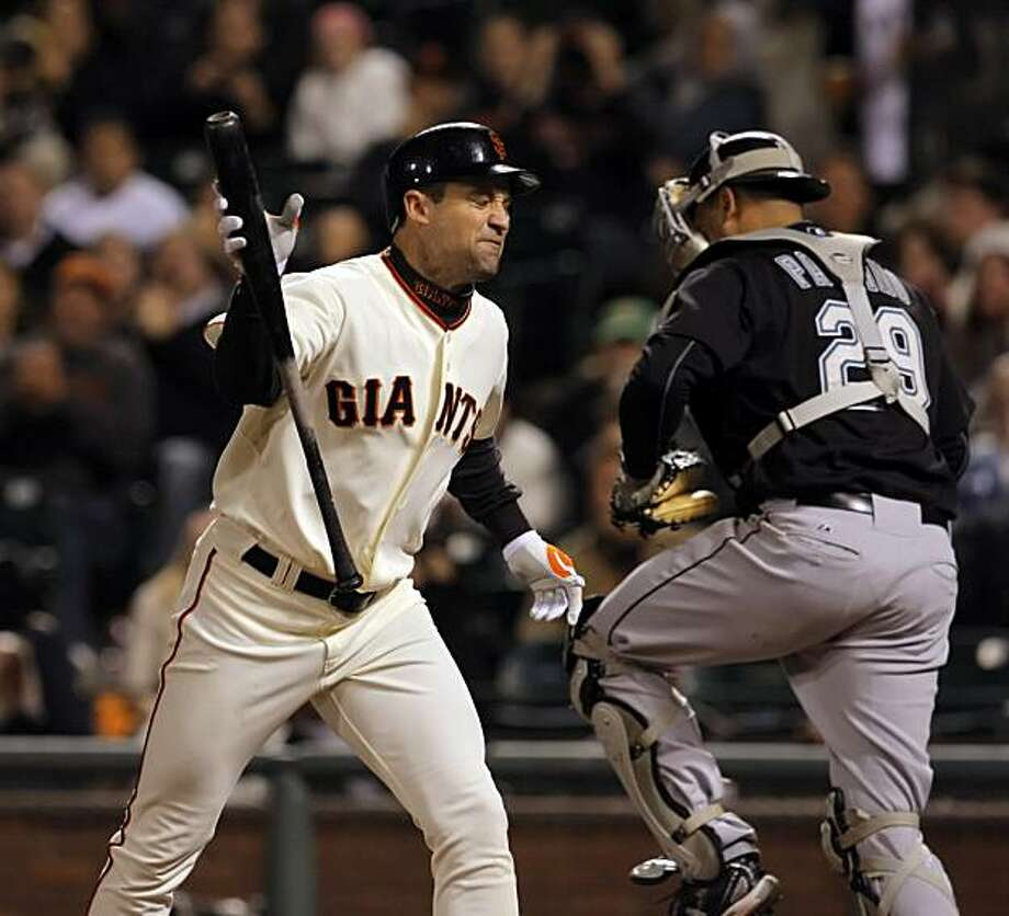 Pat Burrell throws his bat after striking out to end the eighth inning, leaving a runner on base at AT&T Park on Monday. Photo: Carlos Avila Gonzalez, The Chronicle