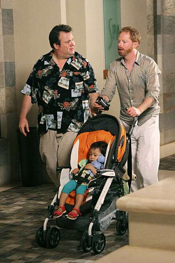 "In this publicity image released by ABC, Eric Stonestreet, left and Jesse Tyler Ferguson are shown in a scene from ""Modern Family."" Photo: Mario Perez, AP"
