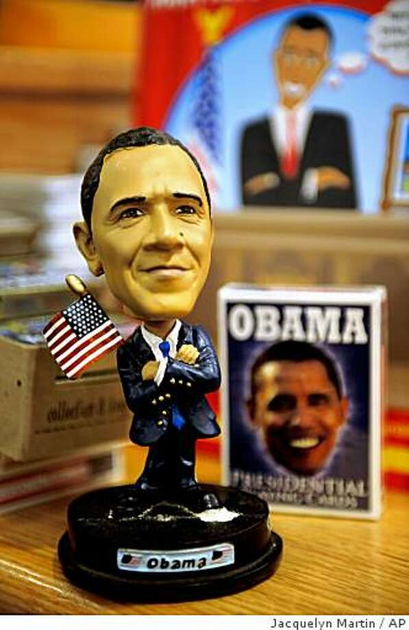 A bobble-head figure with the likeness of President-elect Barack Obama is just one such themed item at a gift store at Union Station in Washington on Tuesday, Dec. 9, 2008. (AP Photo/Jacquelyn Martin) **ADVANCE FOR SUNDAY DEC 14, 1008** Photo: Jacquelyn Martin, AP