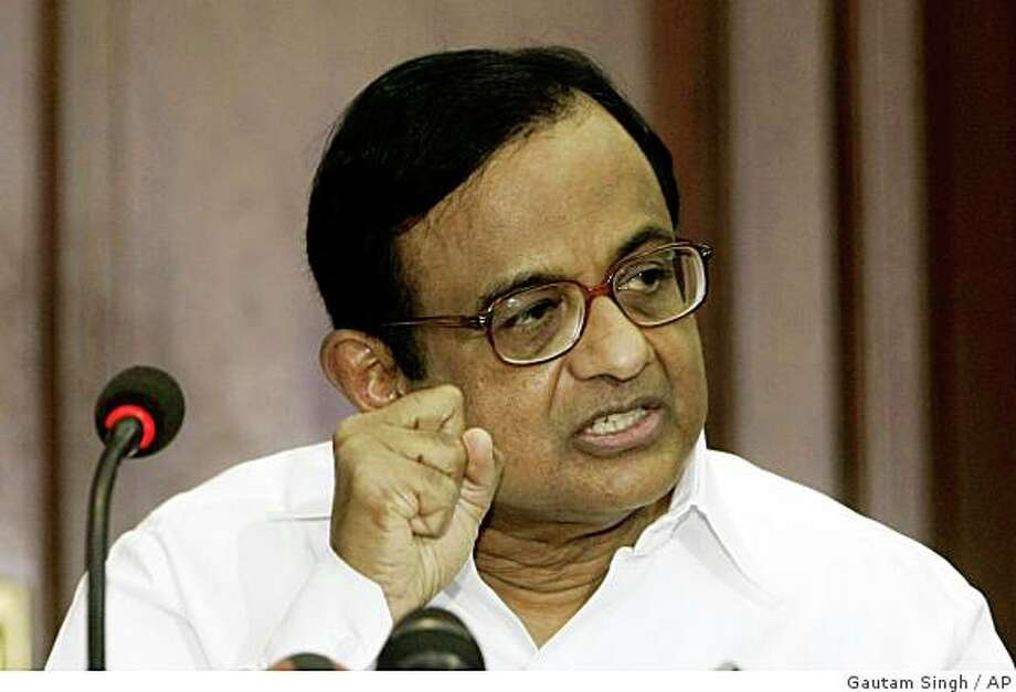 "India's Home Minister Palaniappan Chidambaram gestures during a press conference in Mumbai, India, Friday, Dec. 5, 2008. Chidambaram said Friday ""there have been lapses"" on the government's part in last week's Mumbai attacks. (AP Photo/Gautam Singh) Photo: Gautam Singh, AP"