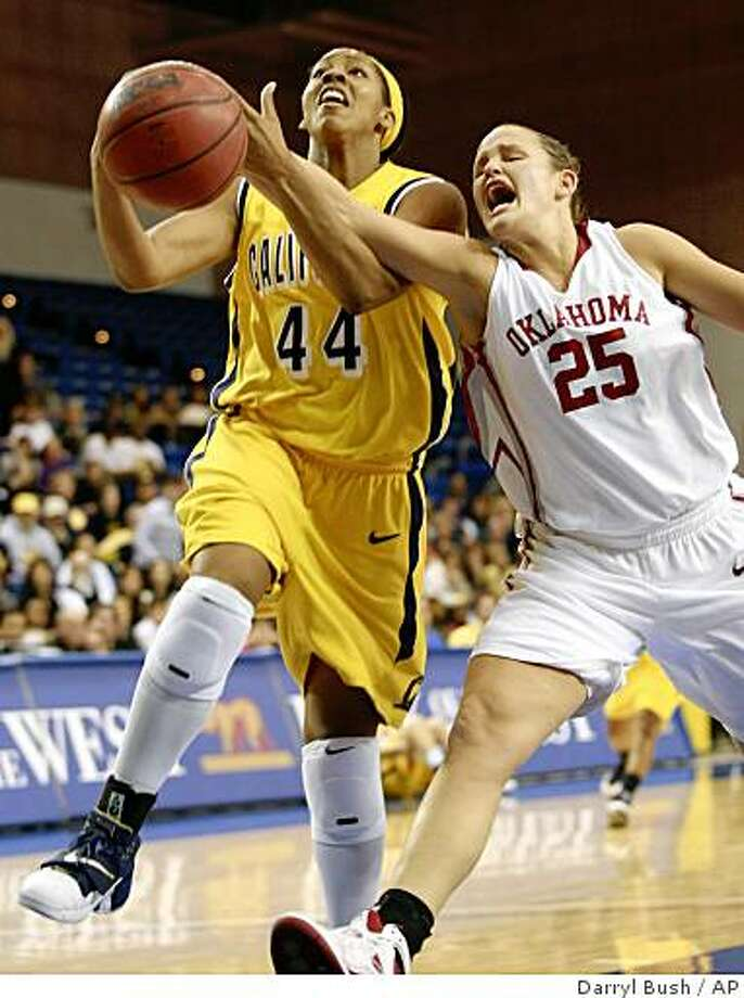 California's Ashley Walker (44) drives to the basket as Oklahoma's Whitney Hand (25) defends in the first half of an NCAA college women's basketball game in San Jose, Calif., Saturday, Dec. 13, 2008. (AP Photo/Darryl Bush) Photo: Darryl Bush, AP