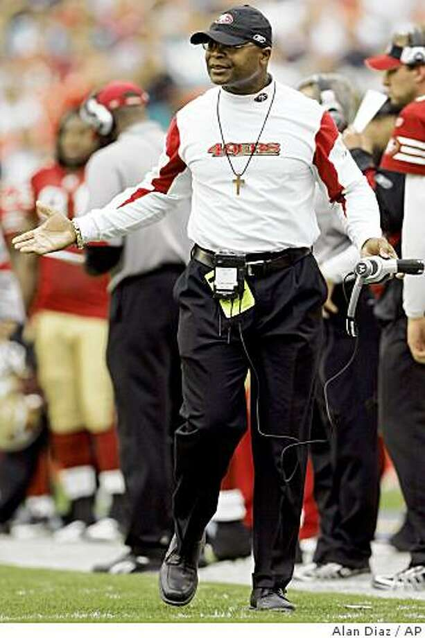 San Francisco 49ers head coach Mike Singletary gestures as he questions a call by a referee in the second quarter of an NFL football game against the Miami Dolphins in Miami, Sunday, Dec. 14, 2008. The Dolphins won 14-9. (AP Photo/Alan Diaz) Photo: Alan Diaz, AP