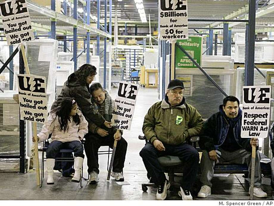 Workers an supporters line the factory floor Sunday, Dec. 7, 2008 on the third day of a sit-in at the Republic Windows and Doors factory in Chicago. The band of 200 workers demanding severance and vacation pay have become a national symbol for the millions of laid off workers across the country after the company abruptly fired them last week prompting them to occupy their former workplace. (AP Photo/M. Spencer Green) Photo: M. Spencer Green, AP