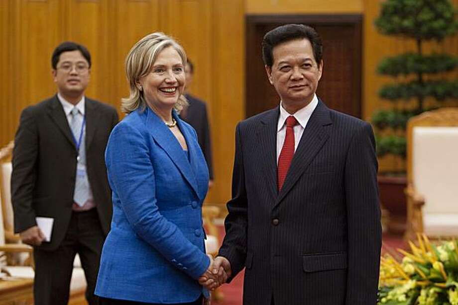 """Hillary Clinton, U.S. secretary of state, left, and Nguyen Tan Dung, Vietnam's prime minister, shake hands at the Office of the Prime Minister in Hanoi, Vietnam, on Thursday, July 22, 2010. The U.S. is ready to take relations with Vietnam to a """"new level"""" 15 years after establishing diplomatic ties with its former adversary, Secretary of State Clinton said. Photographer: Nelson Ching/Bloomberg *** Local Caption *** Hillary Clinton; Nguyen Tan Dung Photo: Nelson Ching, Bloomberg"""