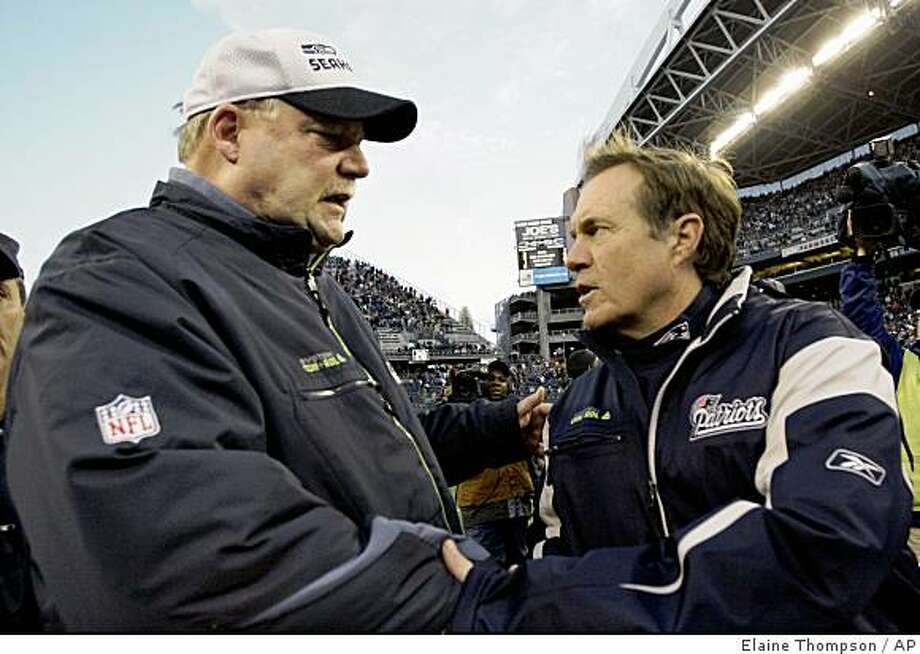 Seattle Seahawks coach Mike Holmgren, left, greets New England Patriots coach Bill Belichick after an NFL football game Sunday, Dec. 7, 2008, in Seattle. The Patriots won 24-21. (AP Photo/Elaine Thompson) Photo: Elaine Thompson, AP