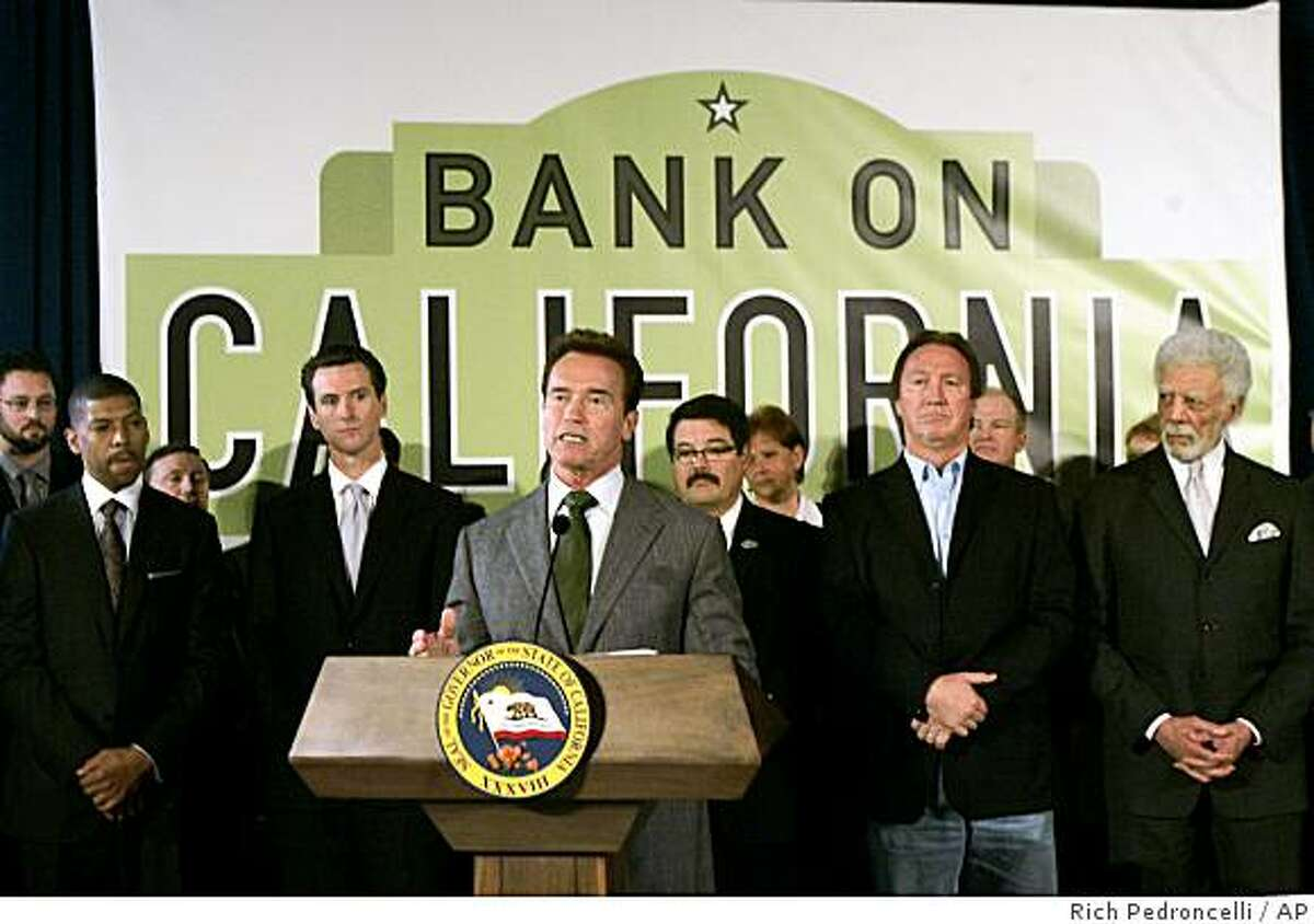 """Gov. Arnold Schwarzenegger, center, announced the creation of a program to encourage Californians to open 100,000 new bank accounts during a news conference at the Capitol in Sacramento, Calif., Friday, Dec. 12, 2008. More then 30 banks and credit unions will receive grants from the foundation started by former President Bill Clinton, to create the """"Bank on California"""" program that will offer residents without checking or savings accounts, the opportunity to open low-or no-fee starter accounts. Schwarzengger was accompanied by city mayors, Kevin Johnson, of Sacramento, left, Gavin Newsom of San Francisco, second from left, Alan Autry of Fresno, second from right, and Ron Dellums of Oakland, right.(AP Photo/Rich Pedroncelli)"""