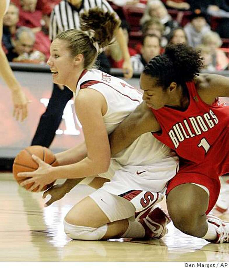 Fresno State forward Taja Edwards (1) tries to strip the ball from Stanford's Kayla Pedersen in the first half of an NCAA college basketball game Saturday, Dec. 13, 2008, in Stanford, Calif. (AP Photo/Ben Margot) Photo: Ben Margot, AP
