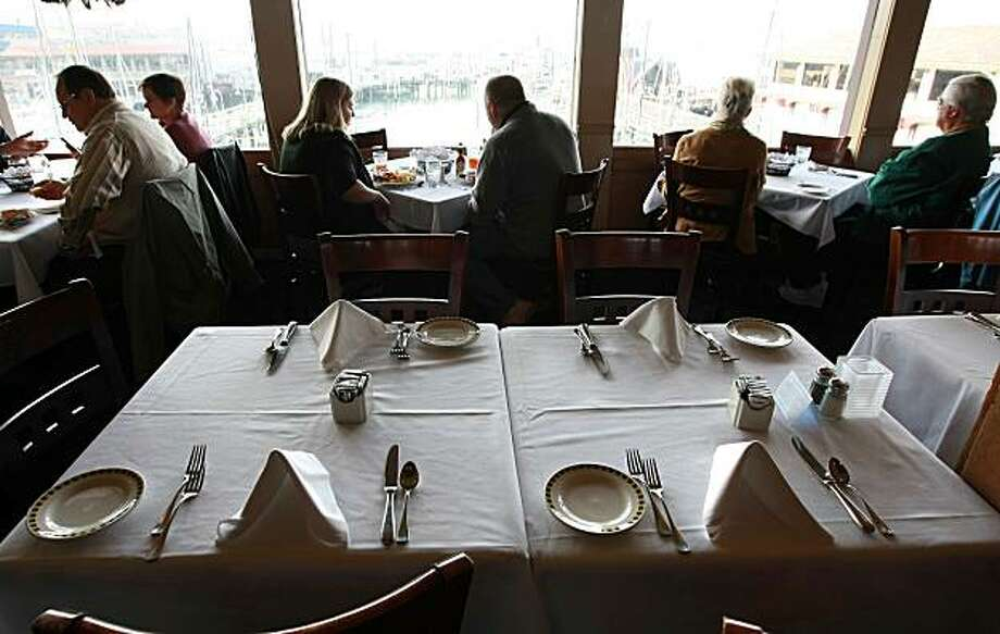SAN FRANCISCO - DECEMBER 03:  A table sits empty during the lunch hour at Alioto's Seafood Restaurant December 3, 2008 in San Francisco, California. A report by The Institute for Supply Management says that its services sector index dropped in November to 37.3, down from 44.4 in October, as the service industry struggles through the weak economy.  (Photo by Justin Sullivan/Getty Images) Photo: Justin Sullivan, Getty Images