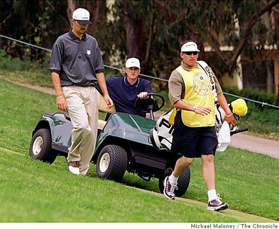 USO MARTIN/C/19JUN98/SP/MJMCasey Martin in cart drives down the 5th fairway as golferEdward Fryatt (left) and caddy walk.Photo by Michael Maloney USO MARTIN/C/19JUN98/SP/MJM Casey Martin in cart drives down the 5th fairway as golferEdward Fryatt (left) and caddy walk. Photo by Michael Maloney Photo: Michael Maloney, The Chronicle