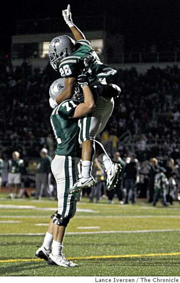 De La Salle #28 jumps into the arms of MacKenzie Park after scoring a 4th quarter touchdown. De La Salle defeated Pittsburg High 34-10 for the North Coast Division 1 Championship Friday Dec 12, 2008. Photo: Lance Iversen, The Chronicle