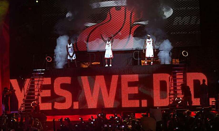 New Miami Heat players LeBron James (6), Chris Bosh (1) and current Heat star Dwayne Wade (3) make their appearance during the welcome ceremony at the American Airlines Arena in Miami, Florida, Friday July 9, 2010. (Hector Gabino/El Nuevo Herald/MCT) Photo: Hector Gabino, MCT