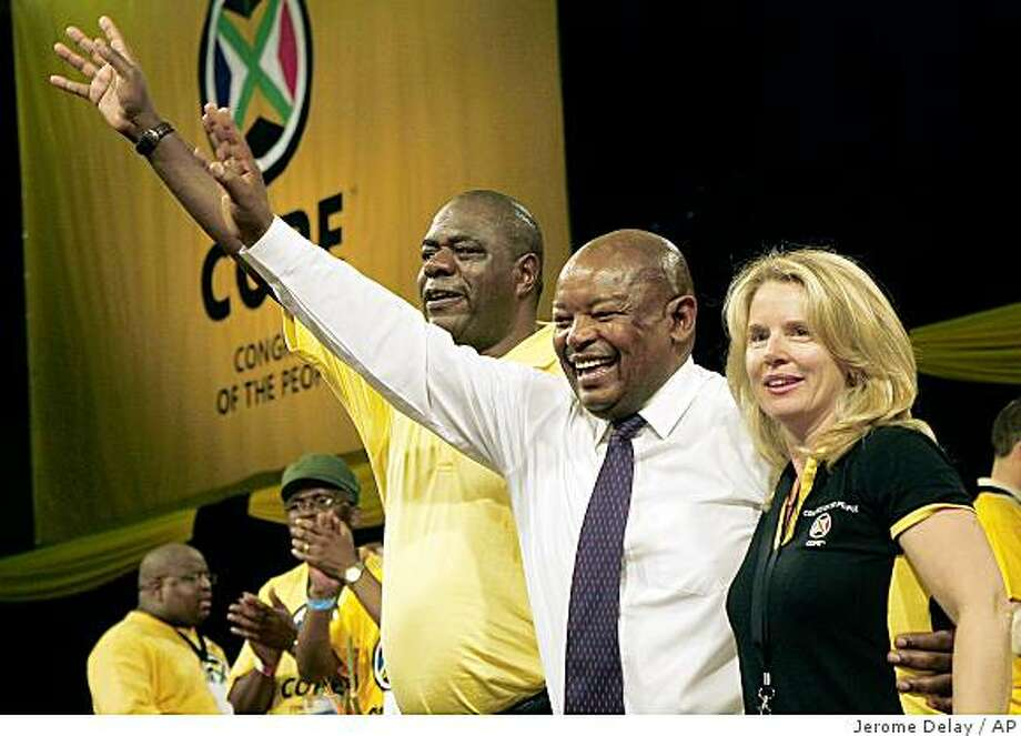 Mosiuoa Lekota, centre, a former defense minister and co-founder of Cope (Congress of the People), breakaway faction of South Africa's African National Congress, reacts, as he is named the leader of the new party, at the final session of Cope's three-day founding conference in Bloemfontein, South Africa, Tuesday Dec. 16, 2008. The president of the governing African National Congress is addressing a rally only hours before ANC rebels formally launch a splinter party in the same heartland South African town. (AP Photo/Jerome Delay) Photo: Jerome Delay, AP