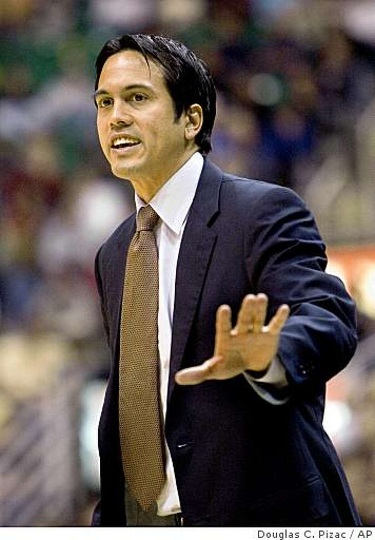 Miami Heat coach Erik Spoelstra has words with an official during the first quarter against the Utah Jazz in an NBA basketball game Wednesday, Dec. 3, 2008, in Salt Lake City. (AP Photo/Douglas C. Pizac)