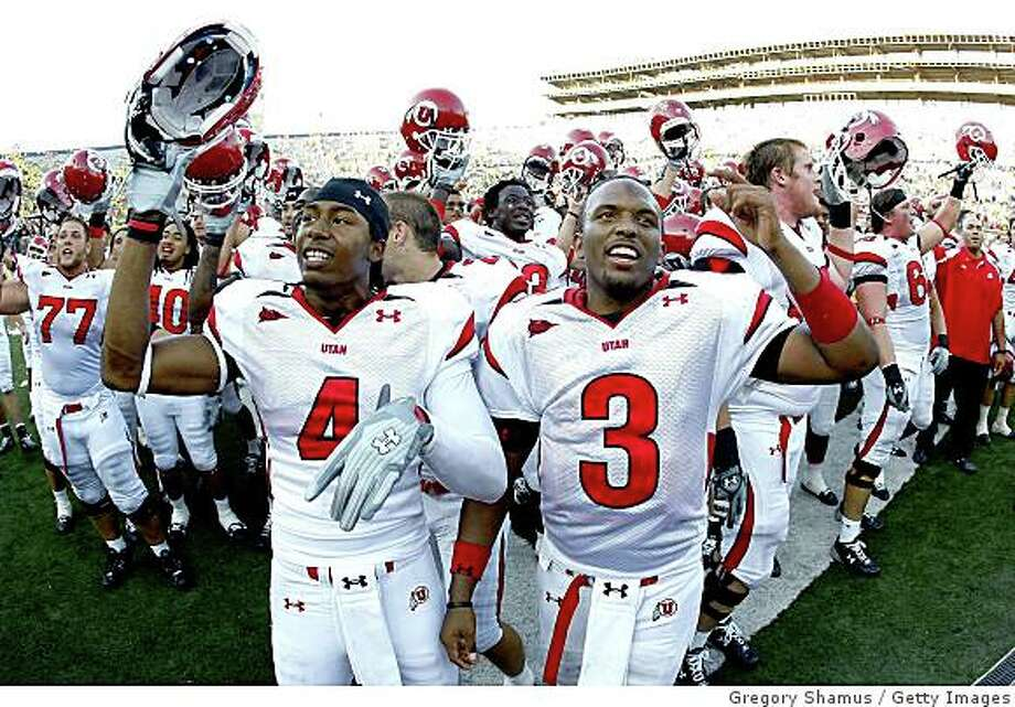 ANN ARBOR, MI - AUGUST 30: Brian Johnson #3 and Sean Smith #4 of the Utah Utes celebrate with teammates after beating the Michigan Wolverines 25-23 on August 30, 2008 at Michigan Stadium in Ann Arbor, Michigan.  (Photo by Gregory Shamus/Getty Images) Photo: Gregory Shamus, Getty Images