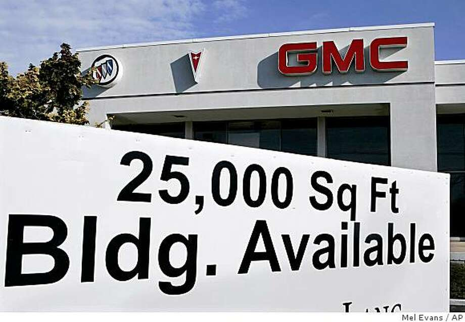 A real estate availability sign is seen in front of a closed auto dealership in East Brunswick, N.J., Sunday Dec. 14, 2008. The Bush administration is considering ways of providing emergency aid to General Motors Corp. and Chrysler LLC, which have said they could run out of cash within weeks without help from the government.  (AP Photo/Mel Evans) Photo: Mel Evans, AP