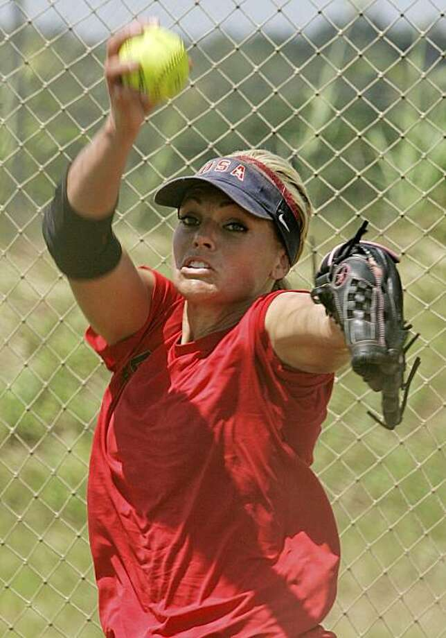 Olympic gold medalist Jennie Finch pitches during a team USA softball practice in Oklahoma City, Tuesday, July 20, 2010. Finch announced  that she will retire next month, playing her final games with the U.S. national team this week at the World Cup of Softball in Oklahoma City. Photo: Sue Ogrocki, AP