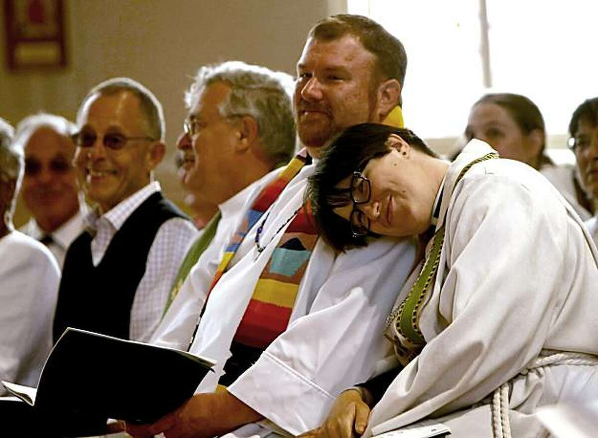 Pastor Megan Rohrer, right cuddle up to Pastor Craig Minich, center, as the service starts, July 25, 2010, at the St. Mark's Lutheran Church, in San Francisco, Calif. They are two of the seven lesbian, gay, bisexual and transgender Lutheran ministers, thaPastor Megan Rohrer, right cuddle up to Pastor Craig Minich, center, as the service starts, July 25, 2010, at the St. Mark's Lutheran Church, in San Francisco, Calif. They are two of the seven lesbian, gay, bisexual and transgender Lutheran ministers, that were officially welcomed to serve in the largest Lutheran denomination in the United States, the Evangelical Lutheran Church in America.