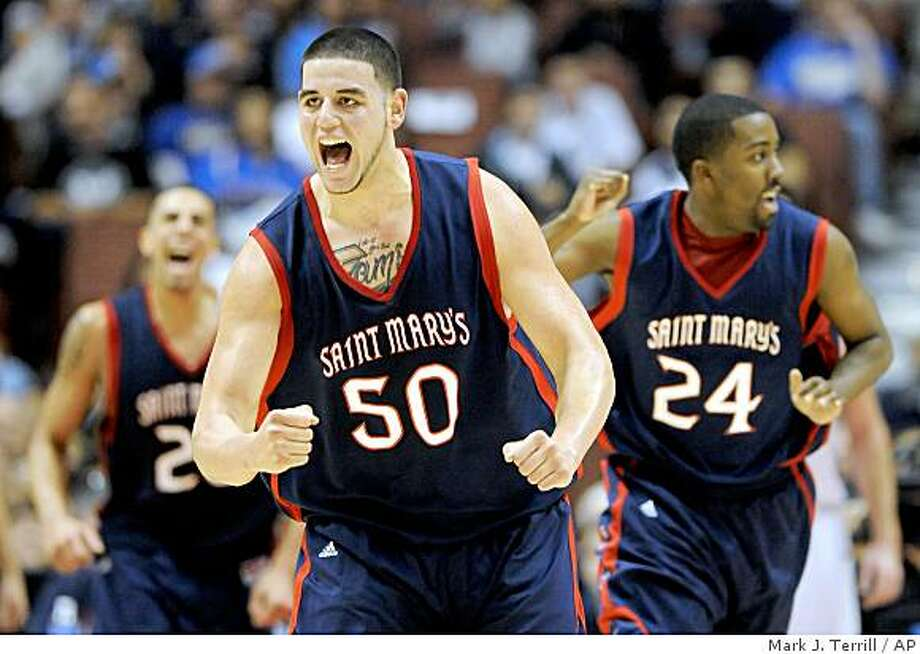 Saint Mary's Omar Samham, center, celebrates after scoring along with teammates Diamon Simpson, left, and Wayne Hunter during the second half of their NCAA college basketball game against San Diego State at the John Wodden Classic, Saturday, Dec. 13, 2008 in Anaheim, Calif. Saint Mary's won 67-64.  (AP Photo/Mark J. Terrill) Photo: Mark J. Terrill, AP