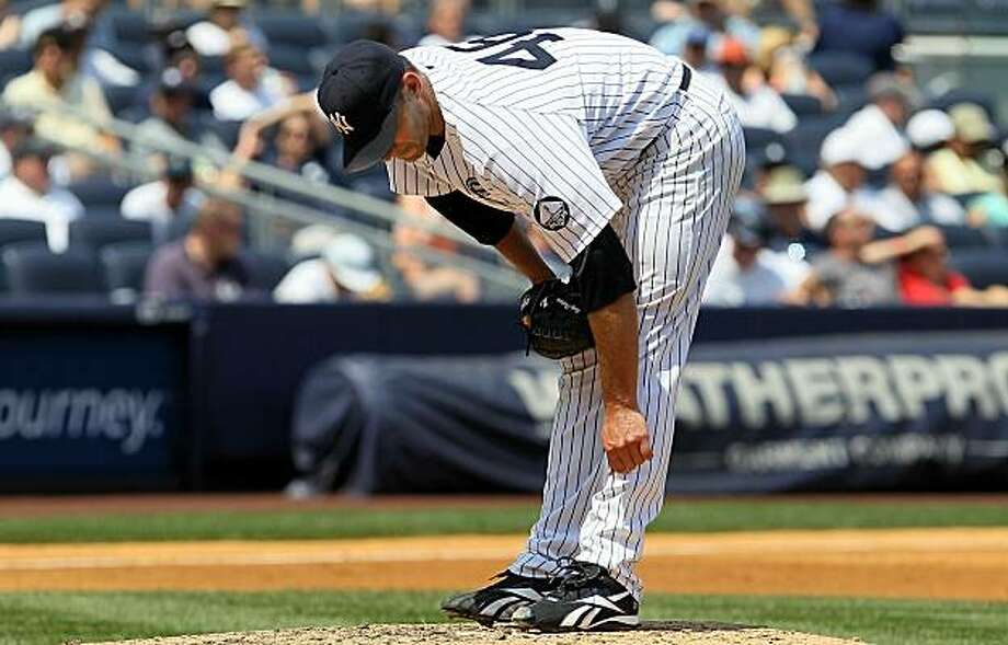 NEW YORK - JULY 18:  Andy Pettitte #46 of the New York Yankees bends over prior to leaving the game in the third inning against the Tampa Bay Rays during the first inning on July 18, 2010 at Yankee Stadium in the Bronx borough of New York City. Photo: Jim McIsaac, Getty Images