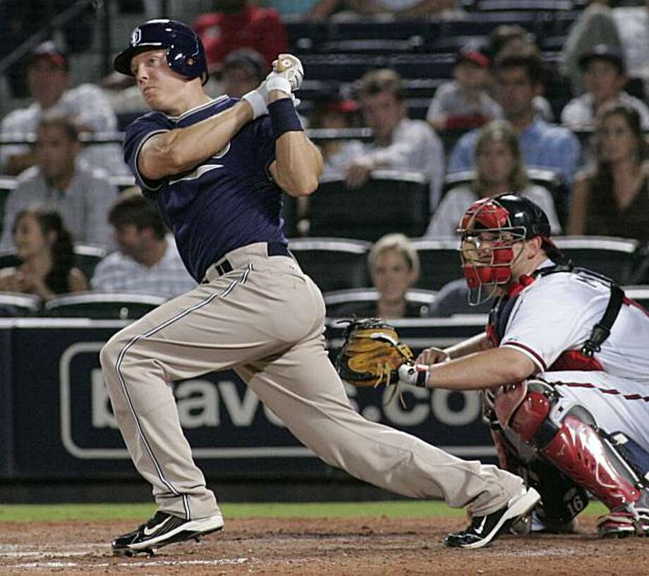** CORRECTS BATTER TO NICK HUNDLEY, INSTEAD OF CHASE HEADLEY - CORRECTS SCORE ** San Diego Padres' Nick Hundley, left, hits the go-ahead two-run double against the Atlanta Braves during the 12th inning of a baseball game in Atlanta, Wednesday July 21, 2010. San Diego won 6-4. Photo: John Amis, AP