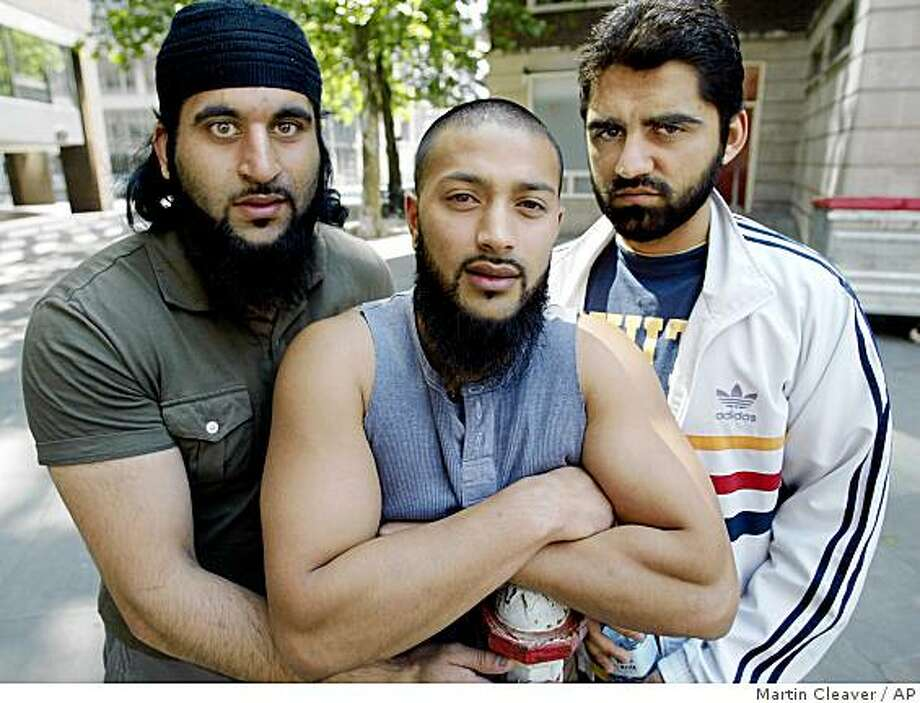 "Shafiq Rasul, Left, Ruhal Ahmed, Centre, and Asif Iqbal, who are the three former Guantanamo Bay detainees known collectively as the ""Tipton Three"", in London Friday June 9, 2006. Photo: Martin Cleaver, AP"