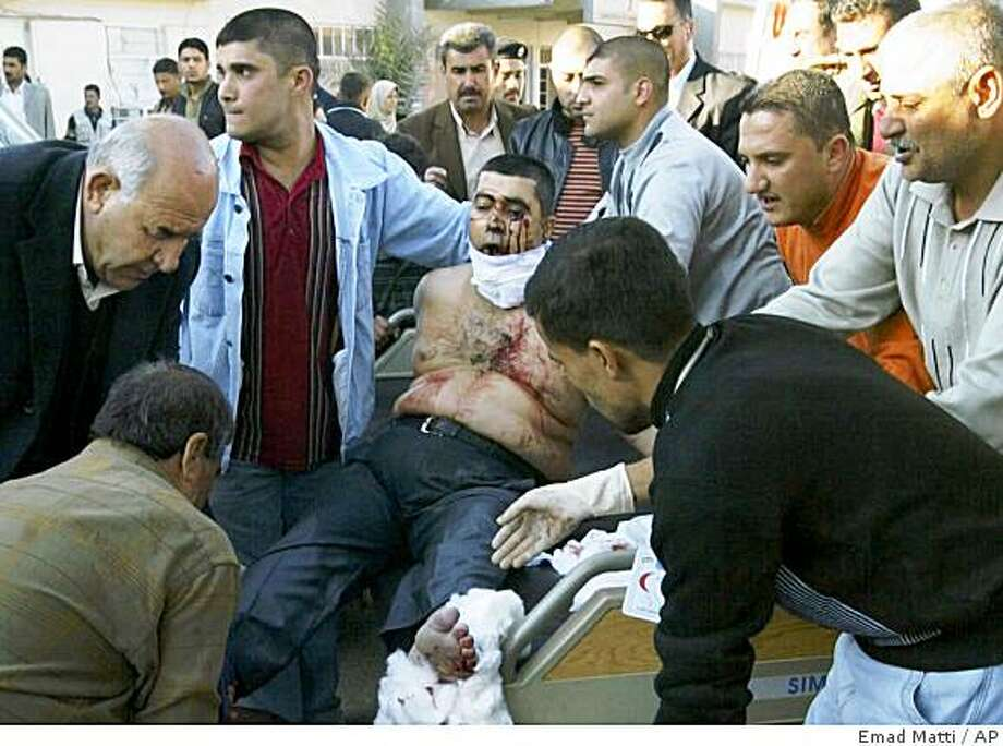A wounded man is brought to a hospital following a suicide bombing in Kirkuk, 290 kilometers (180 miles) north of Baghdad, Iraq, Thursday, Dec 11, 2008. The bomber detonated his explosives inside a popular restaurant killing at least 55 people and wounding 120 others, police said. Arab tribal leaders and Kurdish officials had gathered at the restaurant to discuss ethnic tensions in Kirkuk. Photo: Emad Matti, AP