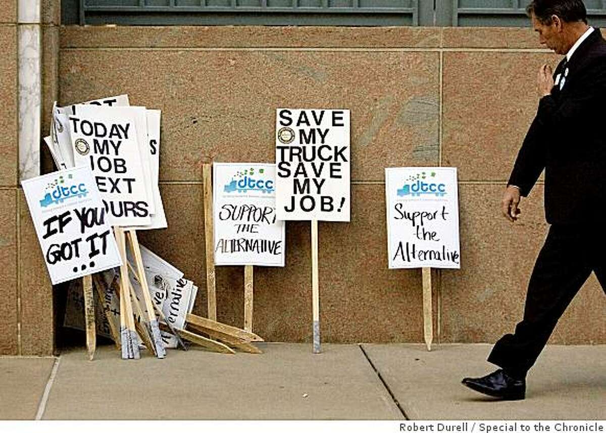 SACRAMENTO, California-A grouping of protest signs sits outside a California Air Resources Board meeting about a plan to replace current diesel engines with new, cleaner models over the new two decades, Sacramento, California, Thursday, December 11, 2008. Signs were not permitted in the meeting.