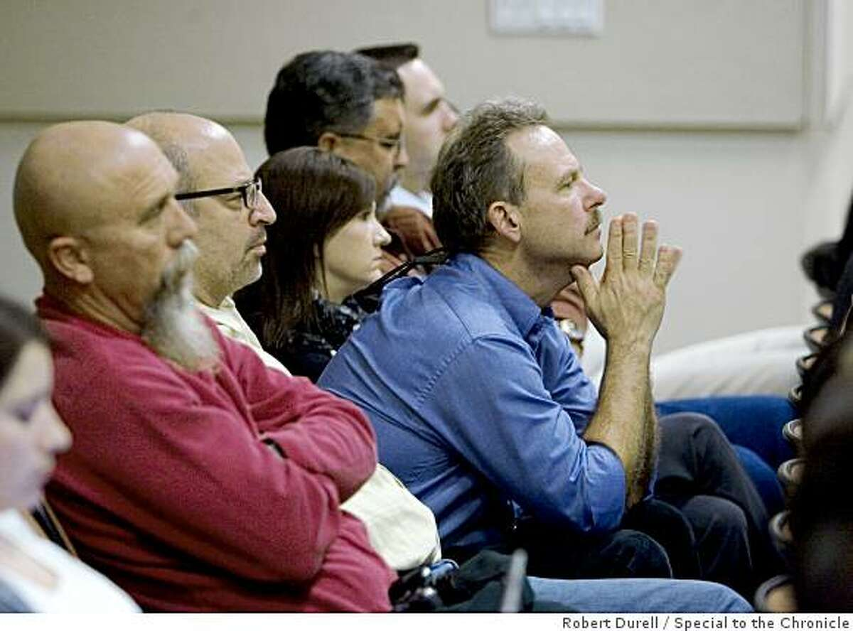 SACRAMENTO, California - Members of the audience listen during a California Air Resources Board meeting about a plan to replace current diesel engines with new, cleaner models over the new two decades, Sacramento, California, Thursday, December 11, 2008.