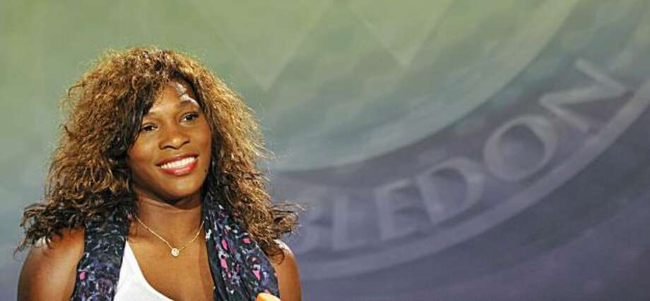 Serena Williams speaks at a press conference , after retaining her title by defeating Vera Zvonareva in the women's singles final at the All England Lawn Tennis Championships at Wimbledon, Saturday, July 3, 2010. Photo: Toby Melville, AP
