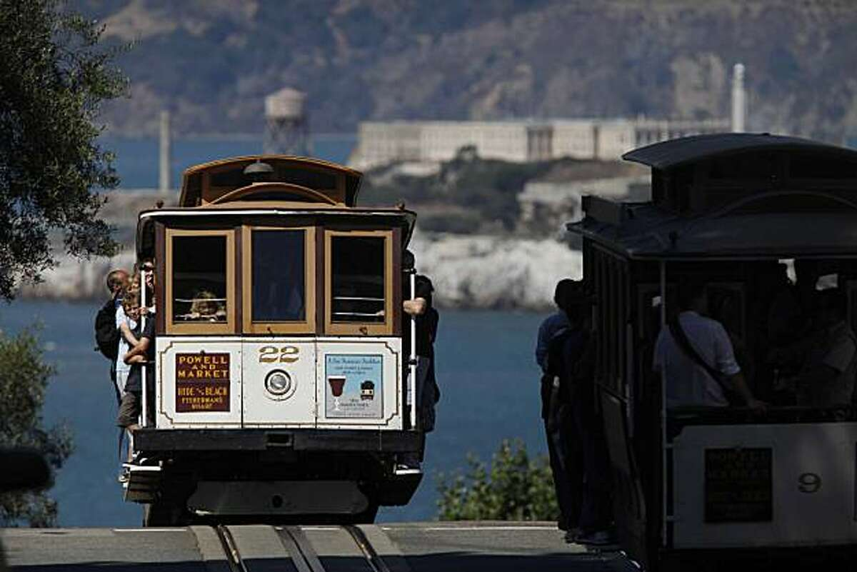 Cable cars meet at the corner of Hyde and Lombard Streets on Thursday Sep. 9, 2009 in San Francisco, Calif.