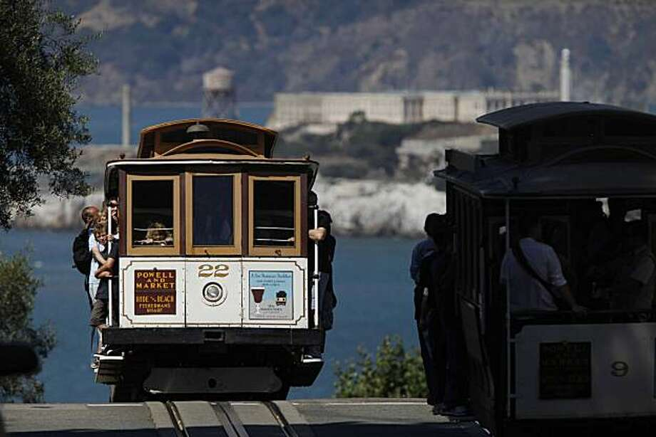 Cable cars meet at the corner of Hyde and Lombard Streets on Thursday Sep. 9, 2009 in San Francisco, Calif. Photo: Mike Kepka, The Chronicle