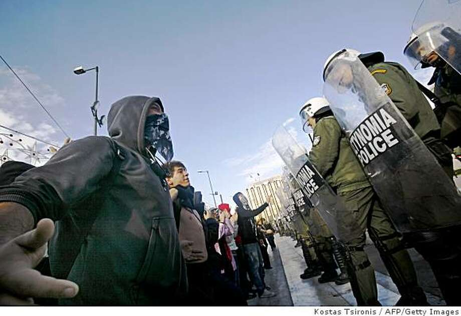 Youths provoke riot police during a demonstration outside Greek Parliament in Athens on December 12, 2008.Greece has experienced seven days of riots, as thousands demonstrated in Athens and Thessaloniki to protest the death of a 15-year-old pupil at the hands of Greek police. Photo: Kostas Tsironis, AFP/Getty Images