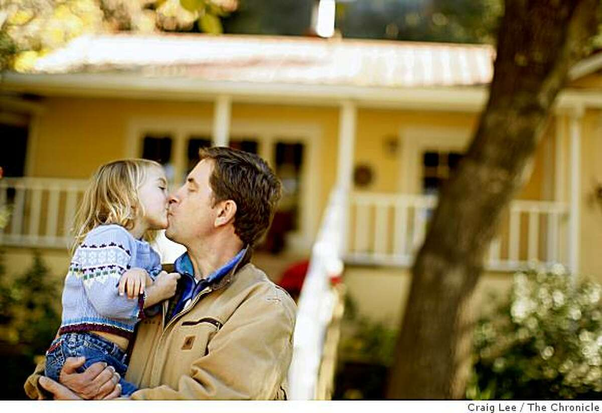Winemaker, Ehren Jordan, gives a kiss to his 3 year-old daughter, Vivien at his Failla winery in St. Helena, Calif., on December 4, 2008.