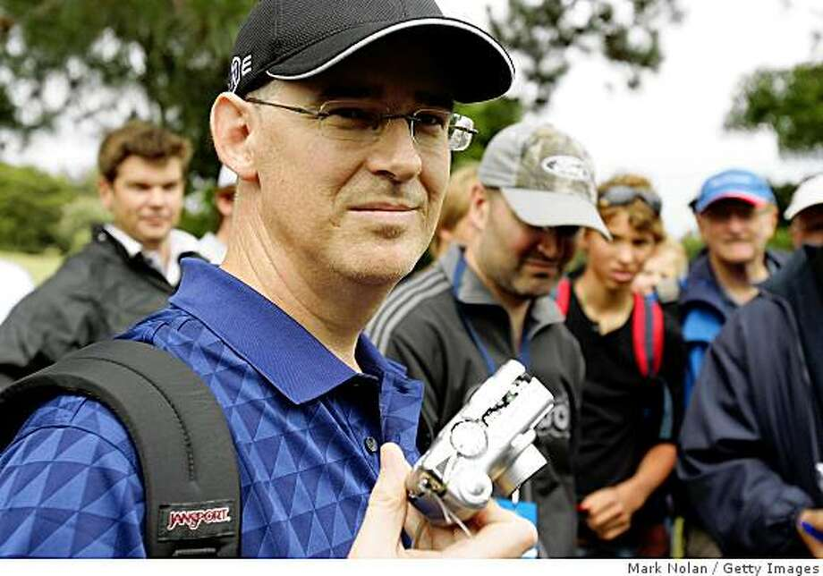 SYDNEY, AUSTRALIA - DECEMBER 11:  Spectator Brad Clegg displays his camera that was thrown against a tree by John Daly of the USA on the ninth hole during the first round of the 2008 Australian Open at The Royal Sydney Golf Club on December 11, 2008 in Sydney, Australia.  (Photo by Mark Nolan/Getty Images) Photo: Mark Nolan, Getty Images