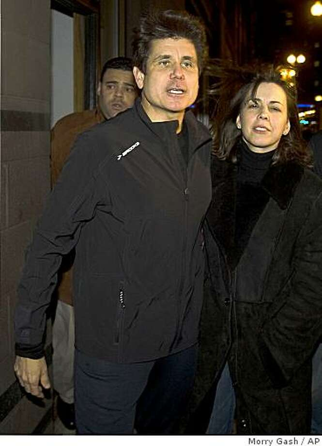 Illinois Gov. Rod Blagojevich and his wife Patti leave a downtown office building Sunday, Dec. 14, 2008, in Chicago. Blagojevich was arrested this week on federal charges that he tried to sell President-elect Barack Obama's vacant Senate seat.  (AP Photo/Morry Gash) Photo: Morry Gash, AP
