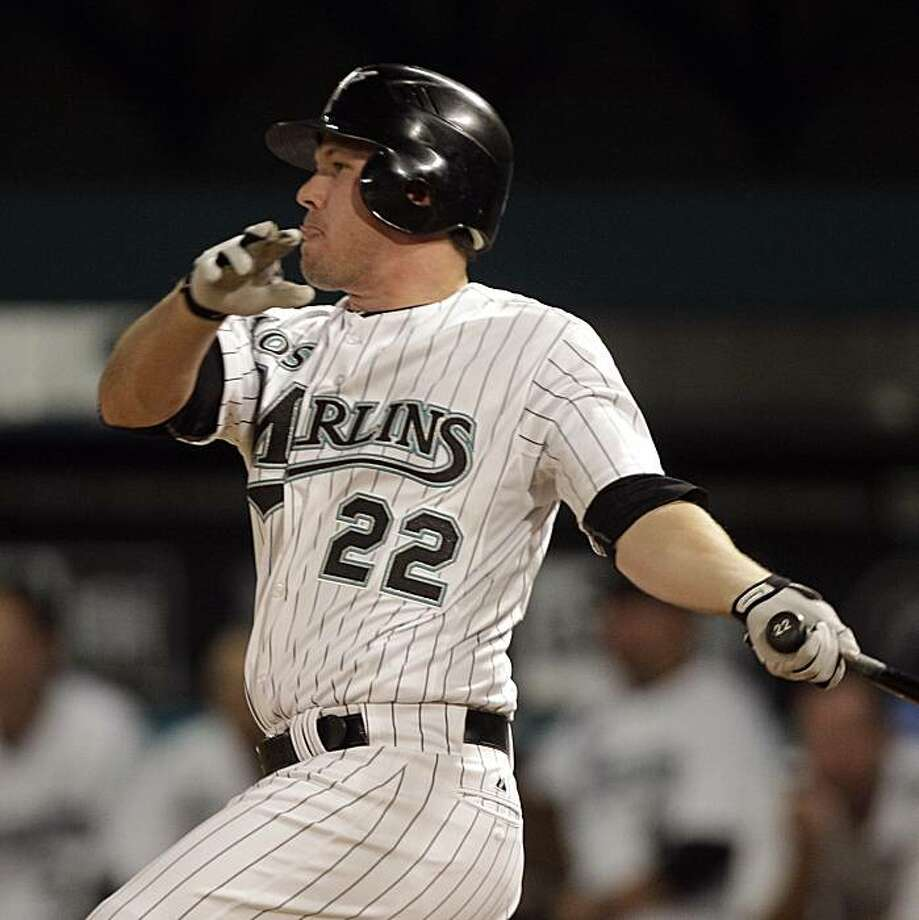 Florida Marlins' Donnie Murphy follows through on his game-winning base hit against the Atlanta Braves in the ninth inning of a baseball game in Miami, Friday, July 23, 2010. Photo: Alan Diaz, AP