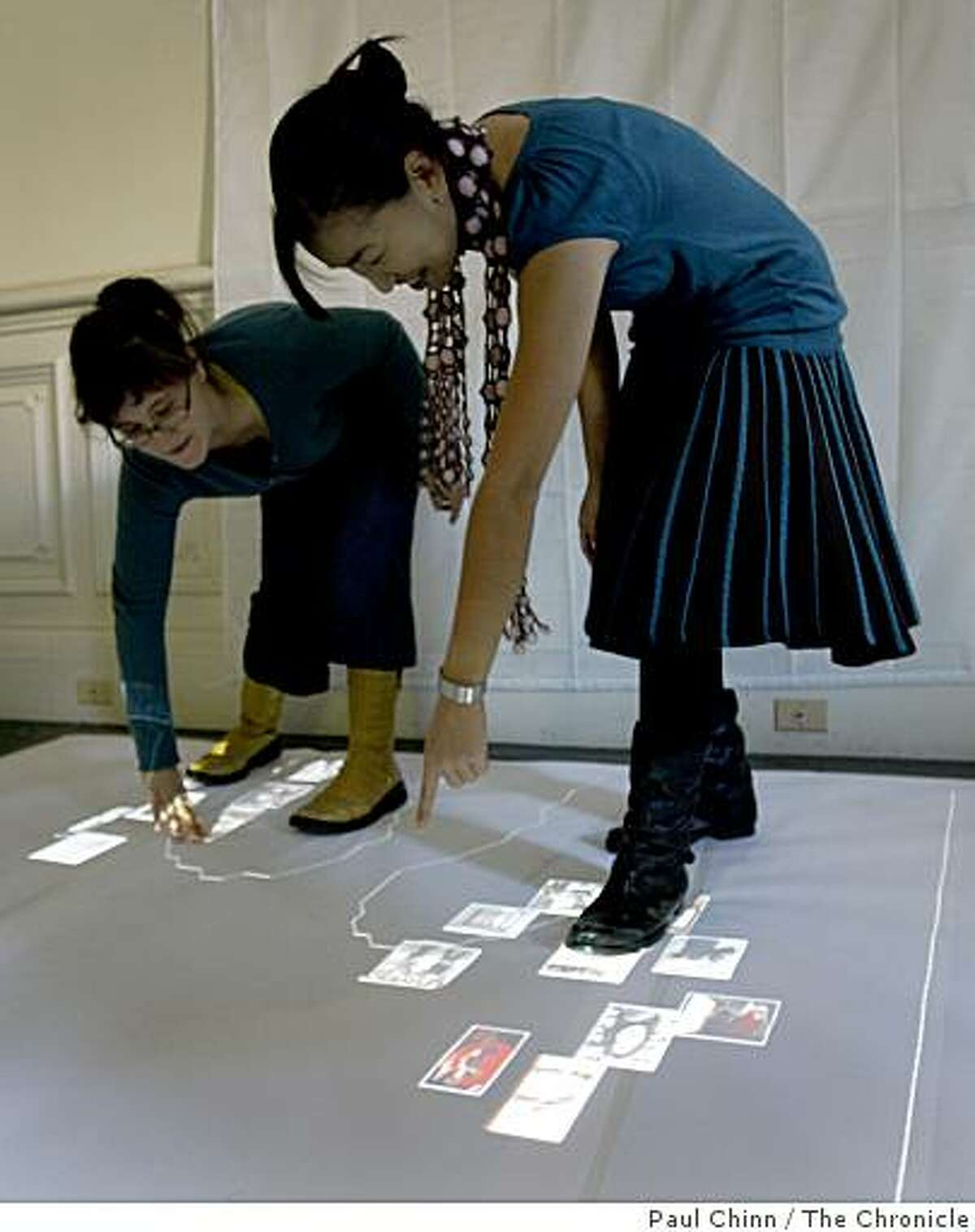 Prof. Kimiko Ryokai, right, and teaching assistant Elizabeth Goodman interact with digital shadows created by students in Ryokai's Theory and Practice of Tangible User Interfaces class at Cal's School of Information demonstrate their projects in Berkeley, Calif., on Tuesday, Dec. 9, 2008.