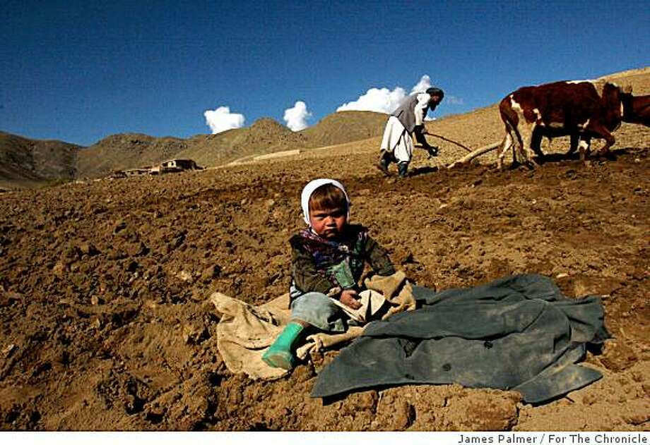 Abdul Kareem, 65, plows his wheat field in preparation for the winter planting season in the Argu district of the Badakhshan province of northern Afghanistan, as his 3-year-old grandson Yahouda Mushin sits nearby on November 3, 2008.The seven year drought in Afghanistan has decimated the farmland and livestock of this predominately agrarian society, jeopardizing the welfare and livelihoods of more than 1 million people across the country while threatening further devastation in the coming winter months.JAMES PALMER / FOR THE CHRONICLE Photo: James Palmer, For The Chronicle