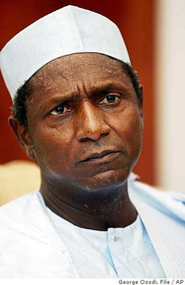 ** FILE ** In this March 30, 2007 file photo Nigerian President Umaru Yar'Adua is seen during an interview in Abuja, Nigeria. Nigeria's Supreme Court upheld Friday Dec. 12, 2008  the results of last year's presidential election rejecting a bid by political opposition leaders in Africa's most populous country to annul the vote. The election won by President Umaru Yar'Adua was marred by rigging and intimidation and deemed not credible by European Union election observers.  (AP Photo/George Osodi, File) Photo: George Osodi, File, AP