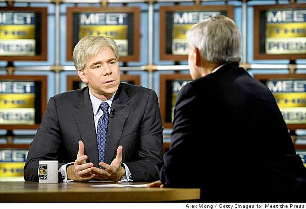 """WASHINGTON - DECEMBER 7: (AFP OUT) David Gregory (L) speaks as he is interviewed by interim moderator Tom Brokaw (R) during a taping of """"Meet the Press"""" at the NBC studios December 7, 2008 in Washington, DC. NBC announced that David Gregory has been chosen to succeed the late Tim Russert and interim moderator Tom Brokaw to become the new moderator and managing editor of the show. (Photo by Alex Wong/Getty Images for Meet the Press)"""
