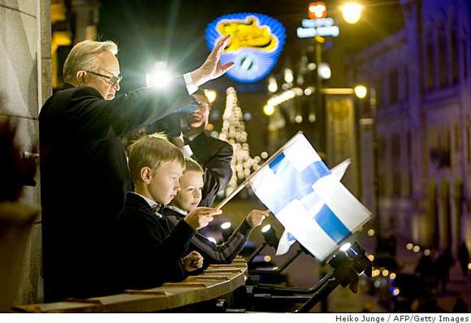 Nobel Peace Prize winner Martti Ahtisaari watches a torchlight procession from the balcony of the Grand Hotel in Oslo, on December 10, 2008. Veteran mediator Martti Ahtisaari insisted Wednesday that all conflicts could be resolved and urged Barack Obama to strive to bring peace to the Middle East as he received the 2008 Nobel Peace Prize. AFP Photo/ Heiko Junge / SCANPIX  NORWAY -NORWAY OUT- (Photo credit should read HEIKO JUNGE/AFP/Getty Images) Photo: Heiko Junge, AFP/Getty Images