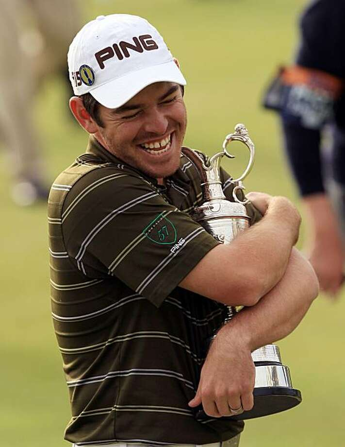 South Africa's Louis Oosthuizen hugs his trophy after winning the British Open Golf Championship on the Old Course at St. Andrews, Scotland, Sunday, July 18, 2010. Photo: Jon Super, AP